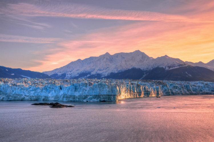 The sun sets over the Hubbard glacier in Alaska
