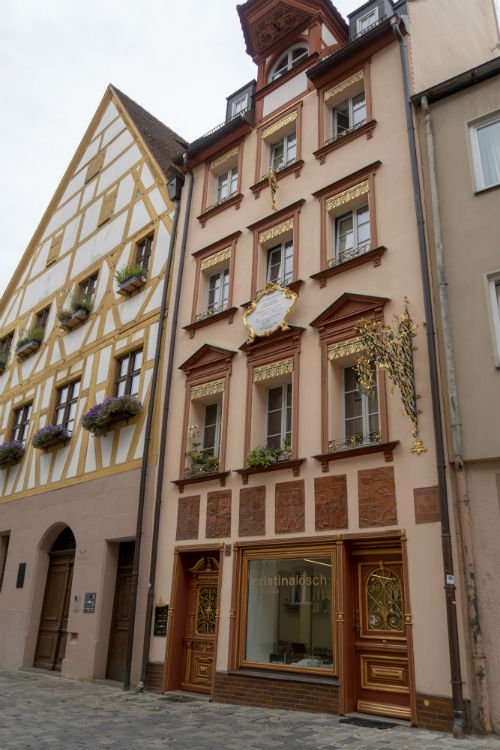 An elaborate building with gold detailing in Weiβgerbergasse in Nuremberg, Germany