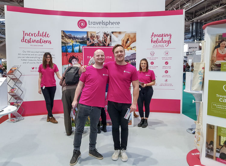 Smiling staff on the Travelsphere stand at the BBC Good Food Show 2018 in Birmingham