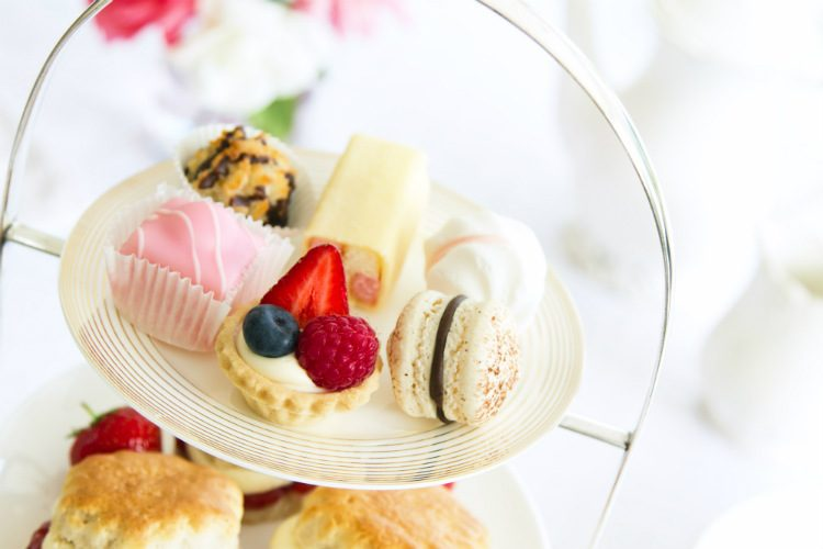 An afternoon tea stand filled with dainty cakes