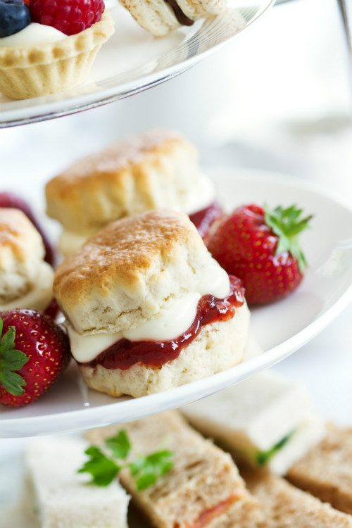 A plate of scones with jam and cream