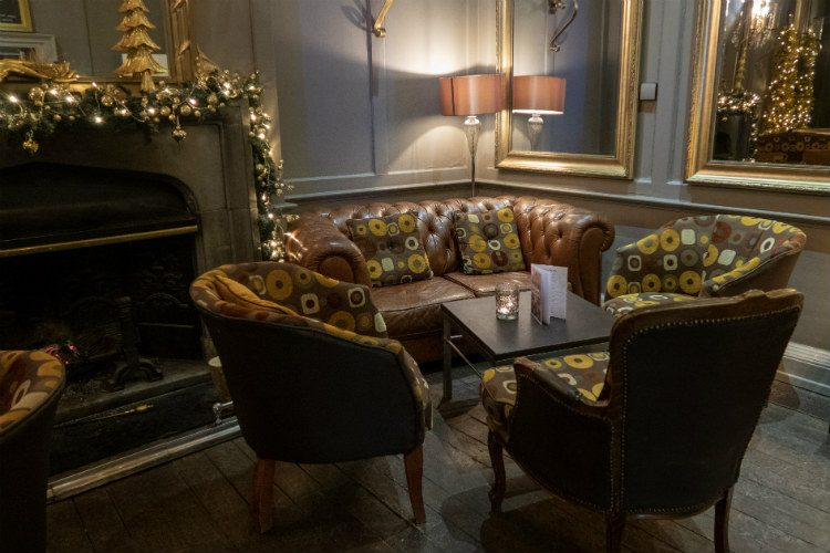 A table and chairs in the corner of the bar at Peterstone Court Hotel & Spa, near Brecon in South Wales.