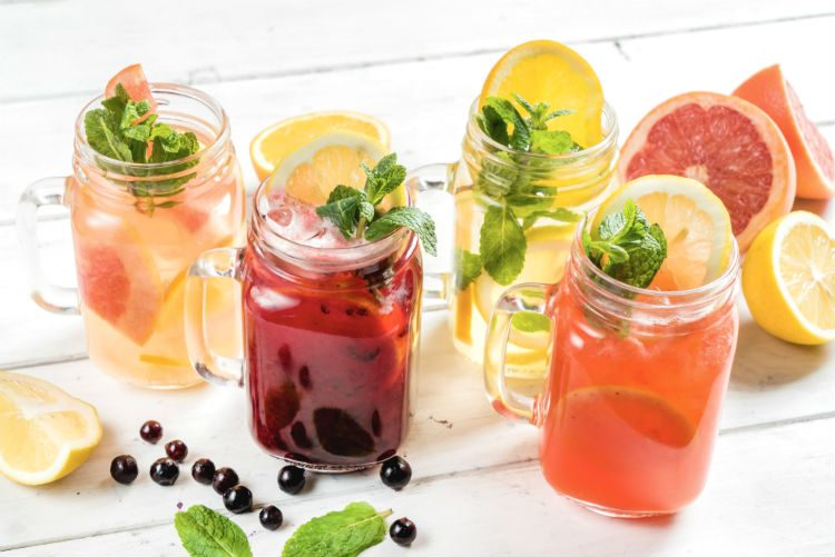 Four glasses of summer fruit coolers in a variety of flavours