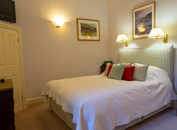 A Classic Double room at Gliffaes Country House Hotel, showing the comfortable double bed with plenty of pillows arranged on it
