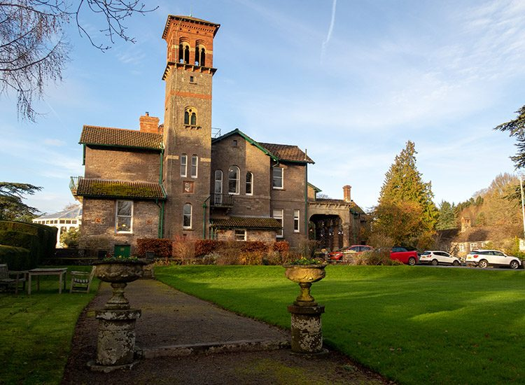 A view of the Italianate bell tower at Gliffaes Country House Hotel, as seen from the gardens