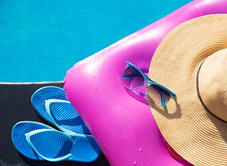 A pool lilo, sunglasses and a sunhat - some of the essentials for a summer break by the pool.