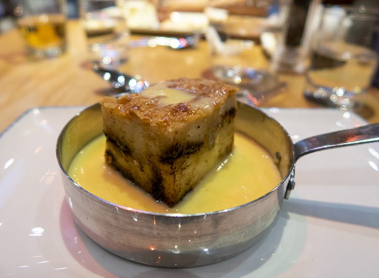 Chocolate bread and butter pudding with custard served for dessert at Warner Leisure Hotels Studley Castle in Warwickshire, England