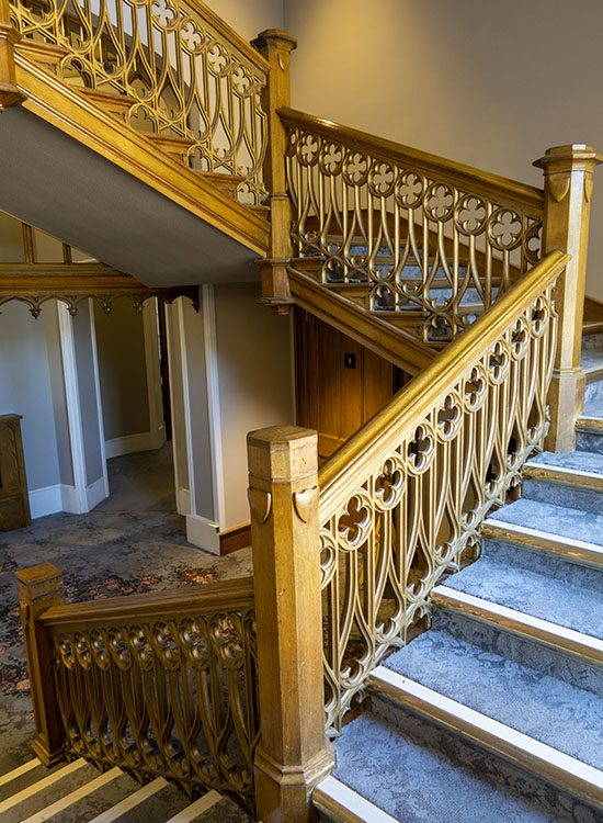 An intricately carved wooden bannister at Warner Leisure Hotels Studley Castle in Warwickshire, England