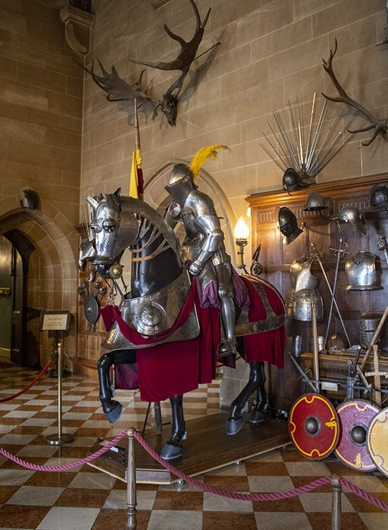 Suits of armour for a knight and his horse, as seen in the Great Hall at Warwick Castle in Warwickshire UK