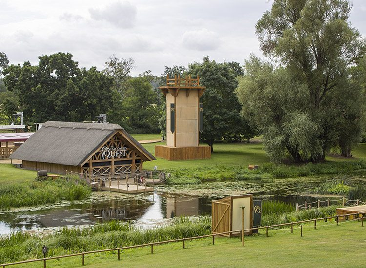 The Riverside Arena is the venue for the Falconer's Quest at Warwick Castle, Warwickshire, UK. The boathouse overlooks the River Avon, and there are trees in the background