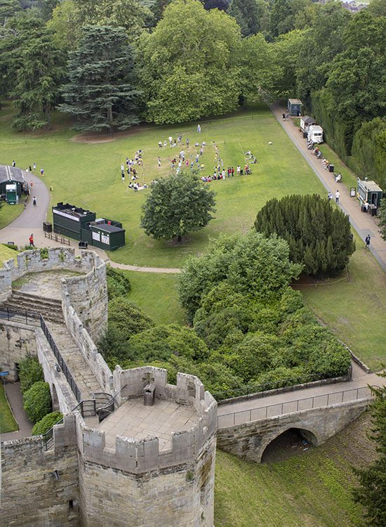 The view from Guy's Tower at Warwick Castle in Warwickshire UK, looking down on Bear Tower and Clarence Tower and the grounds below