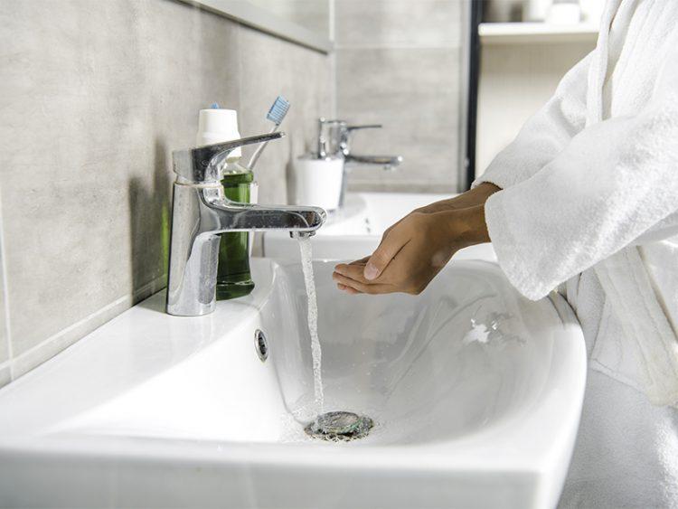 Modern white bathroom basin with sleek chrome fittings