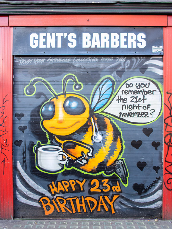 Street art featuring a bee in the Northern Quarter, Manchester, UK