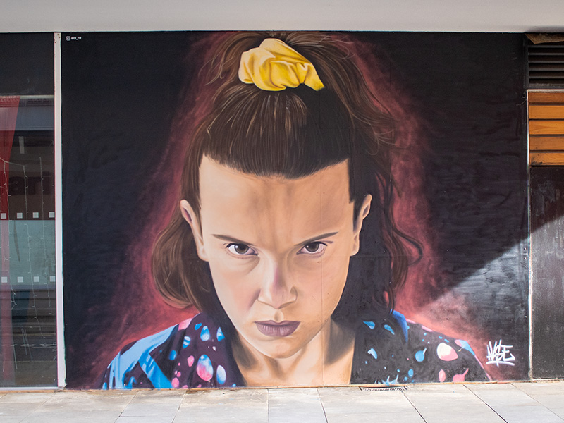 Street art featuring 'Eleven' from the TV show Stranger Things, in the Northern Quarter, Manchester, UK