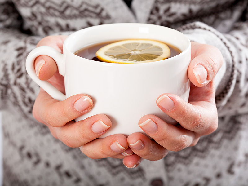 Close-up of hands holding a cup of tea